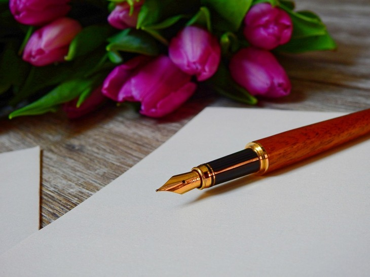 Pen with flowers, letter